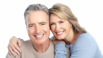 old age couple with white teeth smiling